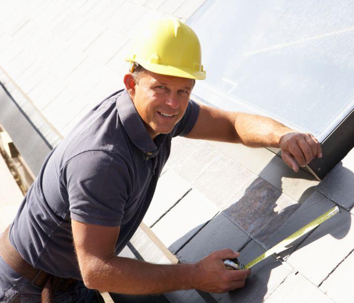 A contractor preparing a roofing estimate in Waltham.